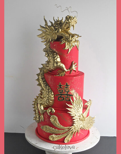 gold dragon and phoenix wedding cake