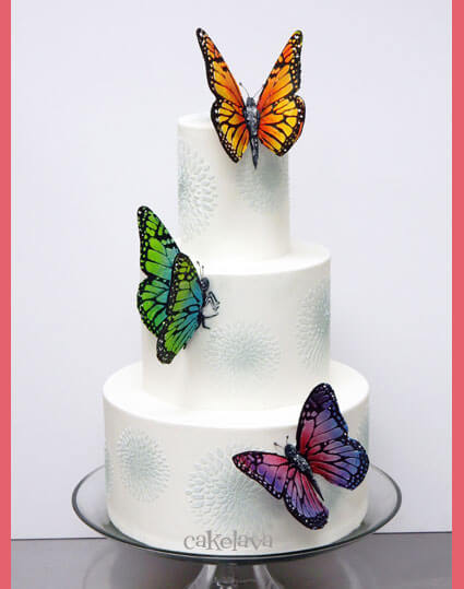 wedding cake with butterflies and flowers