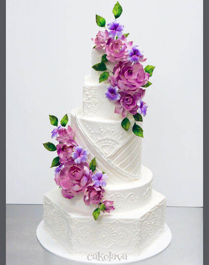 Indian inspired wedding cake with henna design and handmade flowers