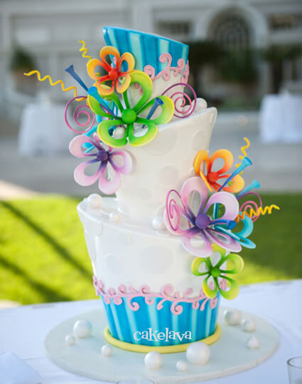 topsy turvy cake with whimiscal flowers