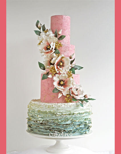 pink and sage wedding cake with ruflles and handcrafted floral cascade