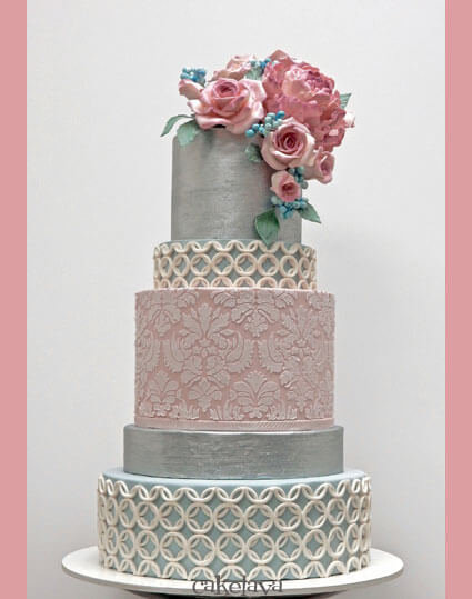 pink, blue and silver wedding cake with textures and handmade flowers