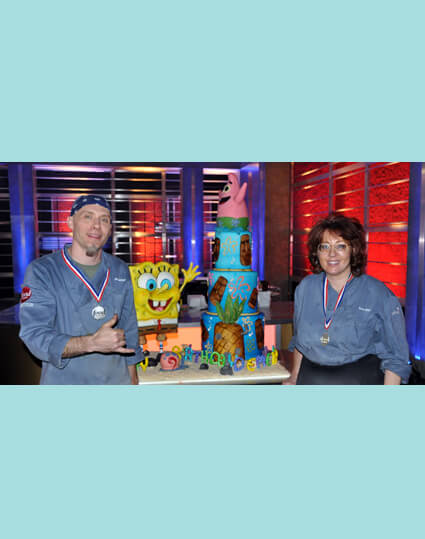 "Cake designer Rick Reichart of cakelava and assistant Annie at Food Network ""Challenge"" TV show"
