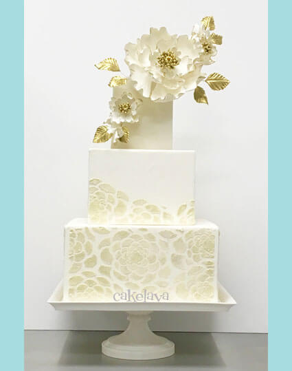 modern wedding cake with handcrafted flowers