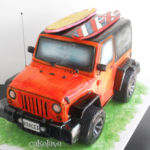 Sculpted jeep with paddleboards cake