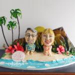 Hawaiian themed cake with custom figurines