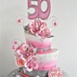 pink wonky cake with flowers
