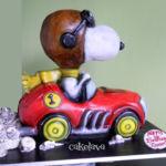 Snoopy in racecar cake