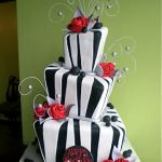 whimsical roses black and white cake