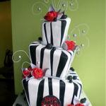 whimsical roses black and white cake