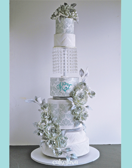 grey and white wedding cake with flowers